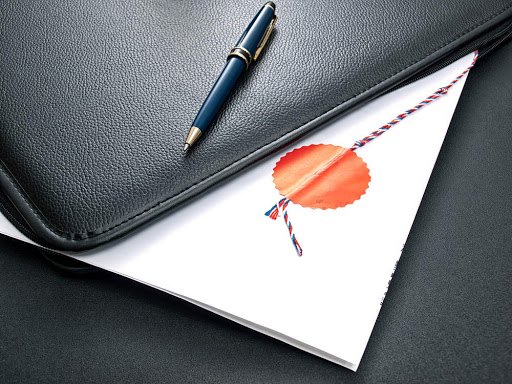 Notary certified agreement in an open folder for documents.